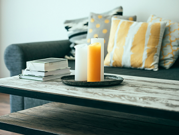 candles and books on top of a coffee table in a living room